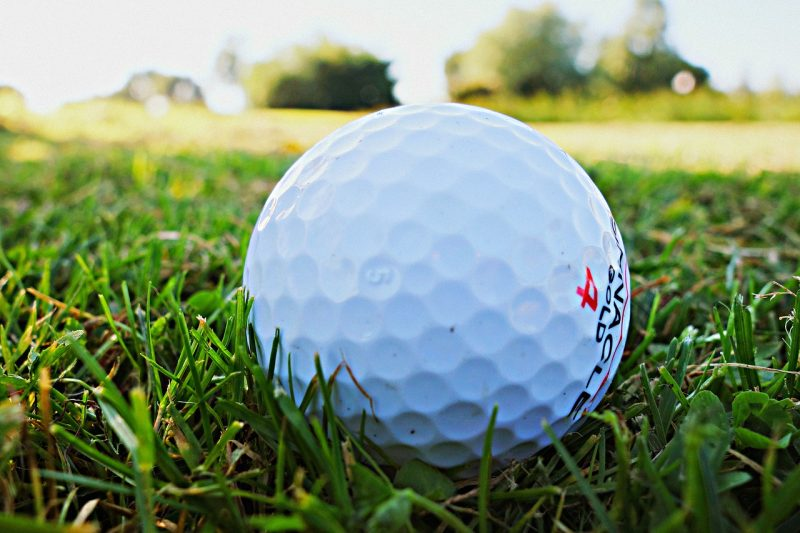 close up of golf ball on golf course